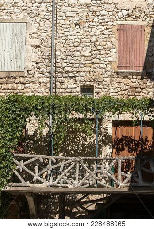 Old Tenement House Overgrown With Ivy In Sault, Vaucluse Department In Provence Region, France