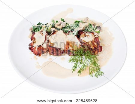Bacon Wrapped Pork Tenderloin With Spinach And Mushrooms. Isolated On A White Background.