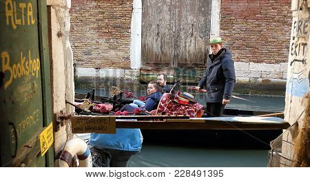 Venice, Italy - January 22, 2018. Gondola With Tourists Passing By Acqua Alta Libreria, Most Famous