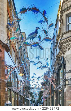 London, England - December 18 , 2017 View Looking Up At The Christmas Lights In Slingsby Place Off L