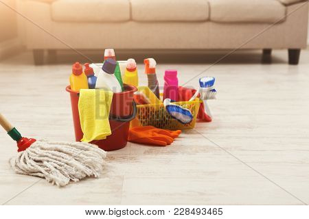 Bucket With Sponges, Chemicals Bottles, Brushes, Towel, Rubber Gloves And Mop. Household Equipment,