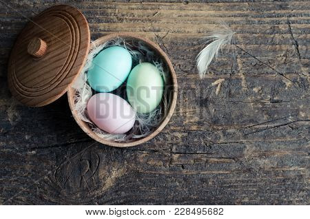 Easter Eggs In Pastel Colors In Bowl On Old Rustic Wooden Background With Empty Place For Text. Happ