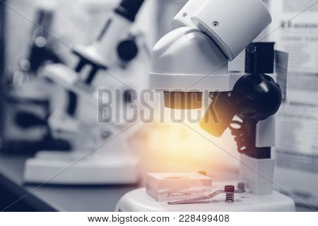 Microscope. Laboratory Microscope Lens. Modern Background Microscopes In Lab.