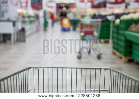 Trolley For Products On Supermarket Background. Shopping