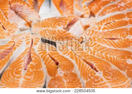 Salmon Red Fish Steak At The Fish Market. Raw Fresh Steaks Of Salmon Fish As Background. Large Pile