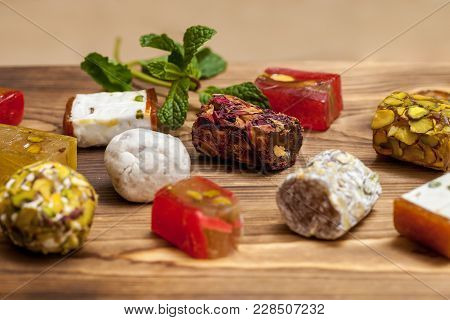 Selection Of Middle Eastern Desserts With Rose Petals, Pistachio And Turkish Delight