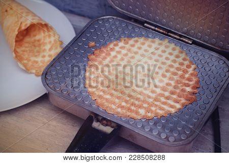 Preparing Homemade Waffles By Waffle Maker Machine. Waffle Tubes Or Rolls. Dessert.