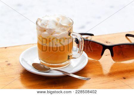 Italian Hot Drink, Bombardino. Italy, Europe. Hot Alcoholic Drink On The Table