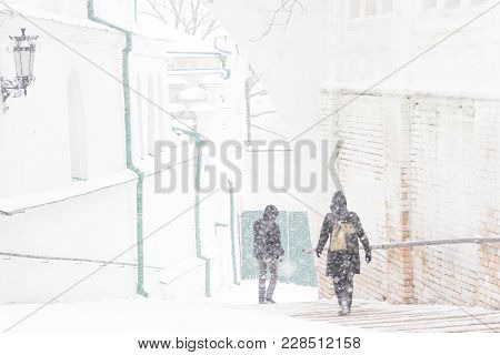 People Walking At Street Way Down. Snow Storm Freeze