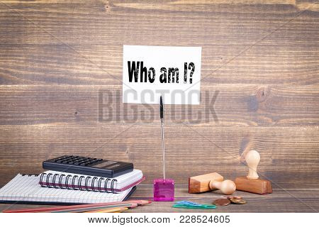 Who Am I. Wooden Table With Stationery.