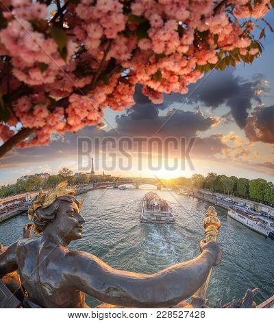 Alexandre Iii Bridge In Paris Against Eiffel Tower During Spring Time, France