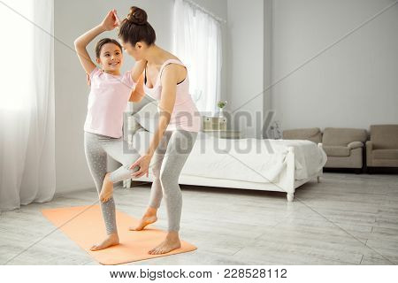 Exercising Together. Attractive Joyful Dark-haired Girl Doing Exercises With Her Mother And Smiling