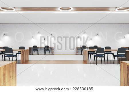 White And Wooden Coworking Interior With A Concrete And Wooden Floor, Blue Chairs And Wooden Tables.