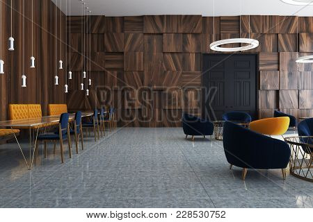 Office Waiting Room Interior With Wooden Walls, A Concrete Floor And Dark Blue And Yellow Armchairs