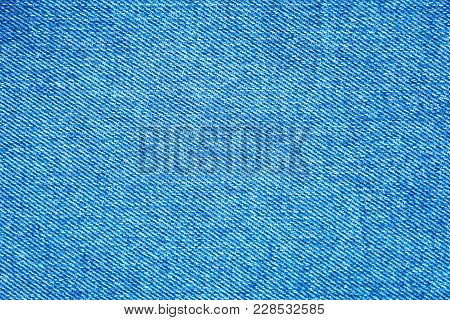 Texture Of Denim Fabric. Blue Jeans Background, Fragment Of Denim Clothing.