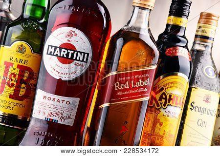 Poznan, Poland - Dec 15, 2017: Bottles Of Assorted Global Liquor Brands Including Martini, Johnnie W