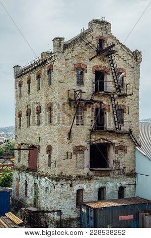 Abandoned Brick Industrial Building Former Elevator Of Factory Of Baked Goods, Novorossiysk, Russia.