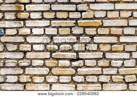 Brick Yellow Wall Backgraund. Old Retro Surface