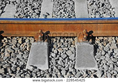 Shot Of Metals And Sleeper On Rail Road Track
