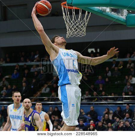 Kyiv, Ukraine - February 26, 2018: Viacheslav Kravtsov Of Ukraine Scores A Slam Dunk During Fiba Wor