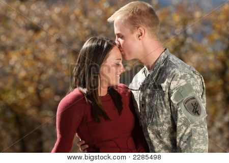 Young American soldier spending time with his girlfriend poster