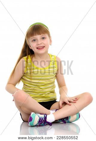 The Gymnast Perform An Acrobatic Element On The Floor.a Girl Gymnast Performs An Acrobatic Element O