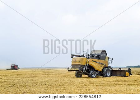 Fields Near Krasnodar, Russia - July 15, 2017: Harvesting Wheat With A Combine Harvester. Field Of R