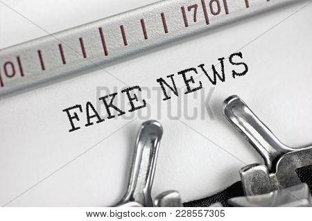 Typewriter Typing Text Fake News, Detailed Macro Closeup, Psychological Operations Newsletter Bullet