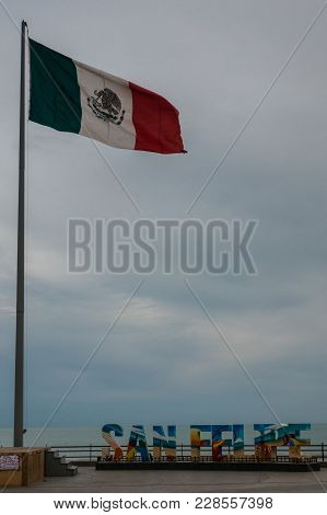 Mexican Flag Flying Proudly Over Tourism Sign In San Felipe Baja California Mexico