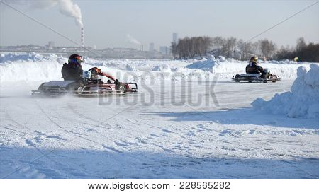 Winter Carting On The Snow Track. Winter Karting Competition On The Ice Track. Winter Carting. Racin
