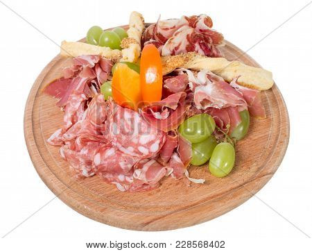 Mixed Italian Dried Meats Platter With Croutons And Grapes. Isolated On A White Background.