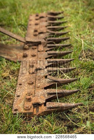 Teeth On A Old Rusted Crop Cutter Bars,