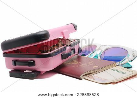 Coins In Pink Luggage, Thai Banknote Currency, Passport And Fashion Sunglasses On White Background F