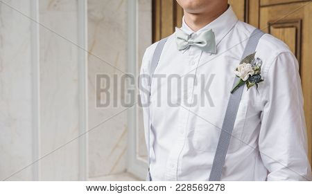 Close-up Young Asian Man In White Shirt With Bow Tie And Suspender