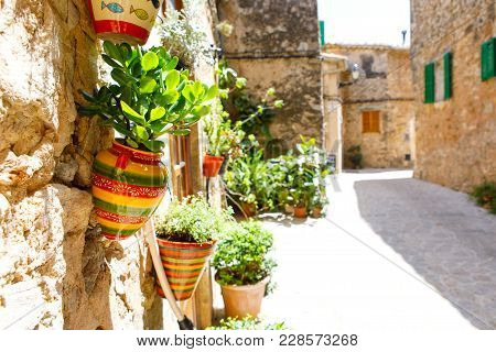 Beautiful Street In Valldemossa With Traditional Flower Decoration, Famous Old Mediterranean Village
