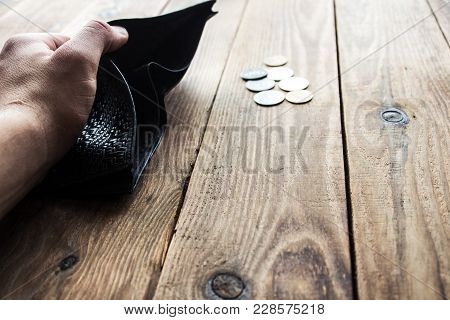 Purse In A Man's Hand And Coins