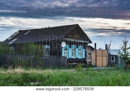 Old Wooden Russian House Made Of Logs In The Village