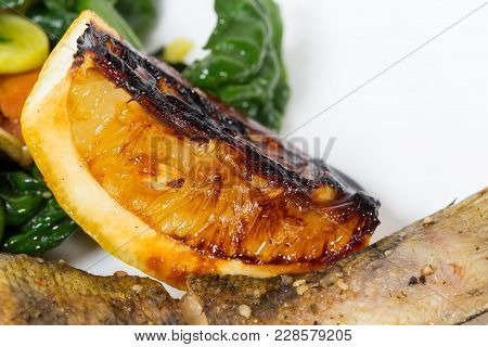 Baked Dorado Fish With Lemon. Macro. Photo Can Be Used As A Whole Background.
