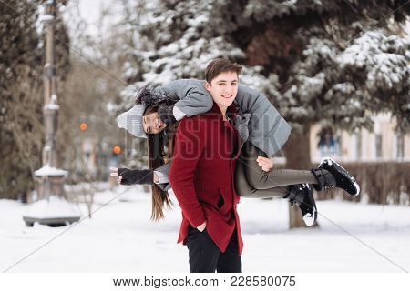 Guy On The Shoulder Is Carrying The Girl, Winter Outdoors.