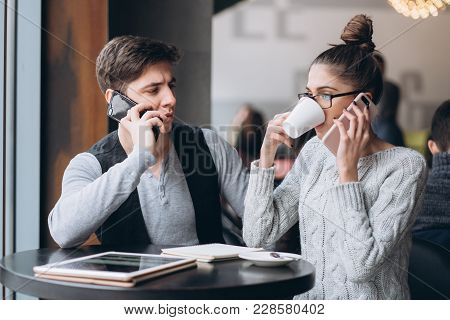 Guy And Girl At A Business Meeting In A Cafe