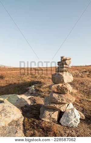 Stack Of Natural Irregular Stones In Grassland