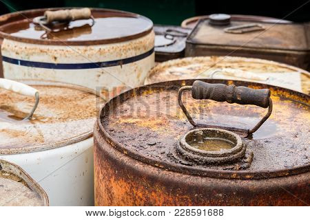 Tops Areas Of Some Old Chemicals Containers With Handles.