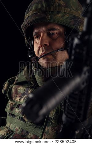 Special Forces Soldiers In Action On The Black Background