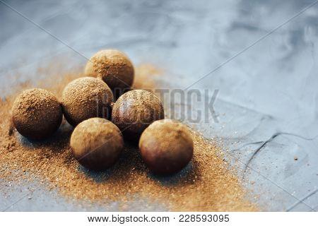 Black Chocolate Round Bon Bon Covered With Cinnamon Powder