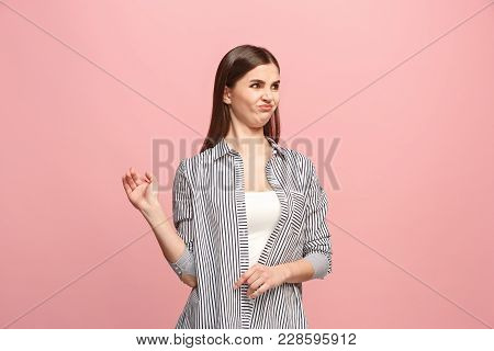 Young Woman With Disgusted Expression Repulsing Something, Isolated On The Pink