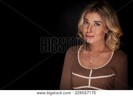 Caucasian Woman With Fair Hair Over Black