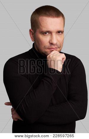 Handsome Guy Wearing Black Turtleneck Thinking