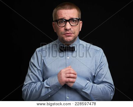Miserable Man Wearing Glasses And Bow Tie