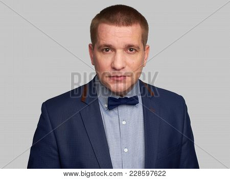 Handsome Man In Blue Suit And Bow Tie