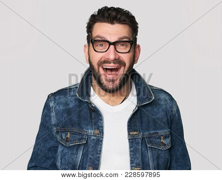 Happy Man Wearing Glasses And Denim Clothes